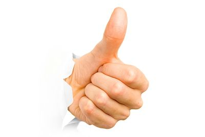 Hand with thumb up has broken through a paper.